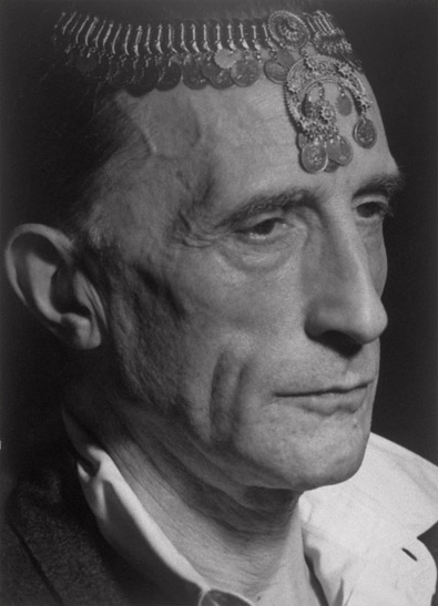 man-ray-marcel-duchamp-with-turkish-coin-necklace-on-forehead-hollywood-1949-gelatin-silver-print