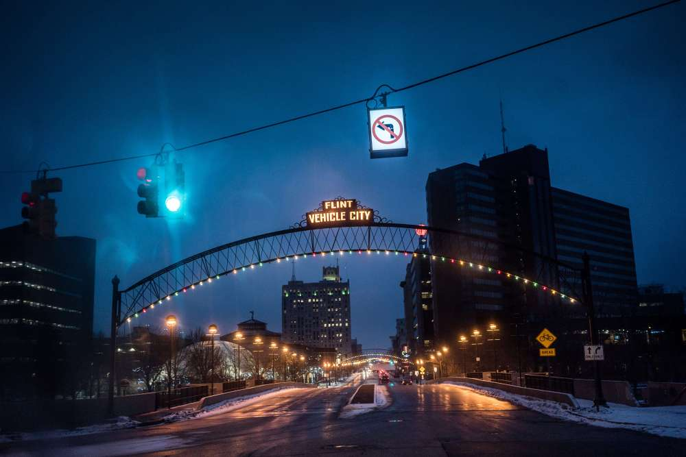 The iconic Vehicle City sign hangs over the entrance to Downtown Flint.