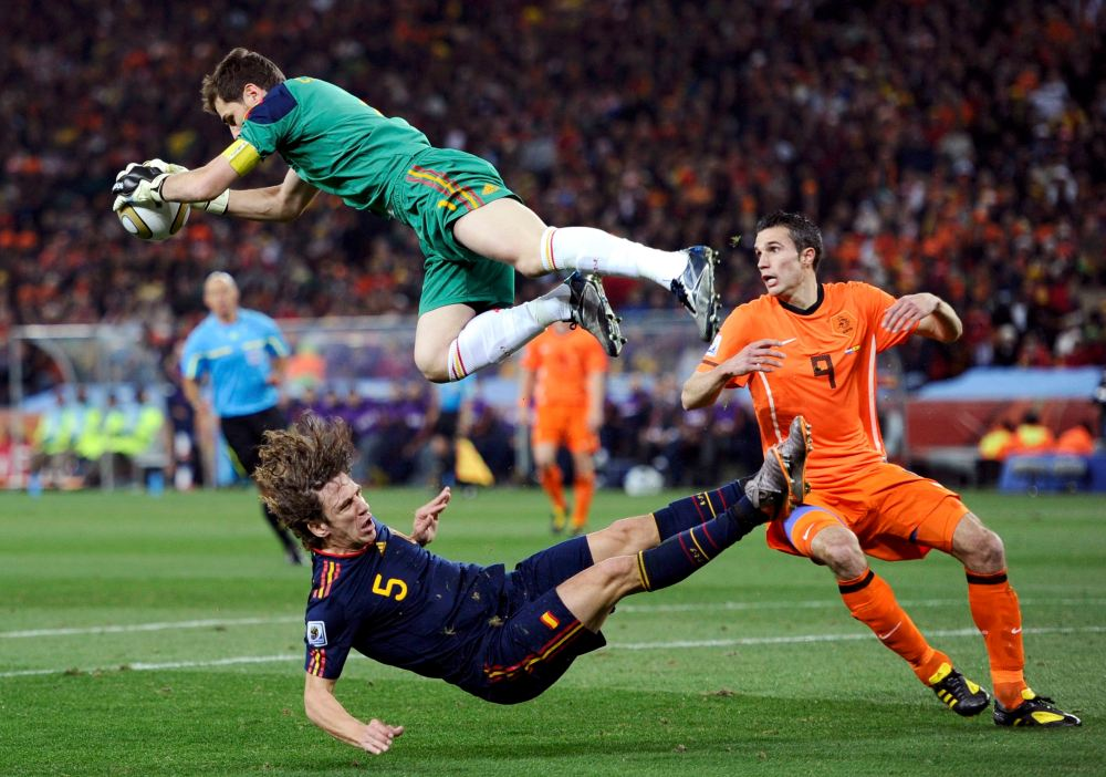 Spain's goalkeeper Iker Casillas jumps up to catch the ball during their 2010 World Cup final soccer match at Soccer City stadium
